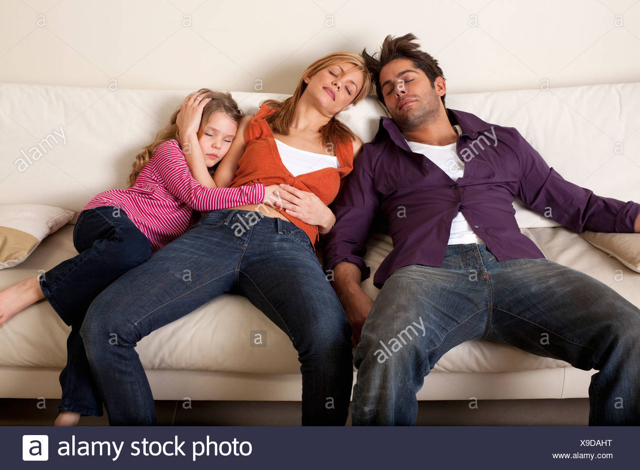 tired family asleep - Stock Image