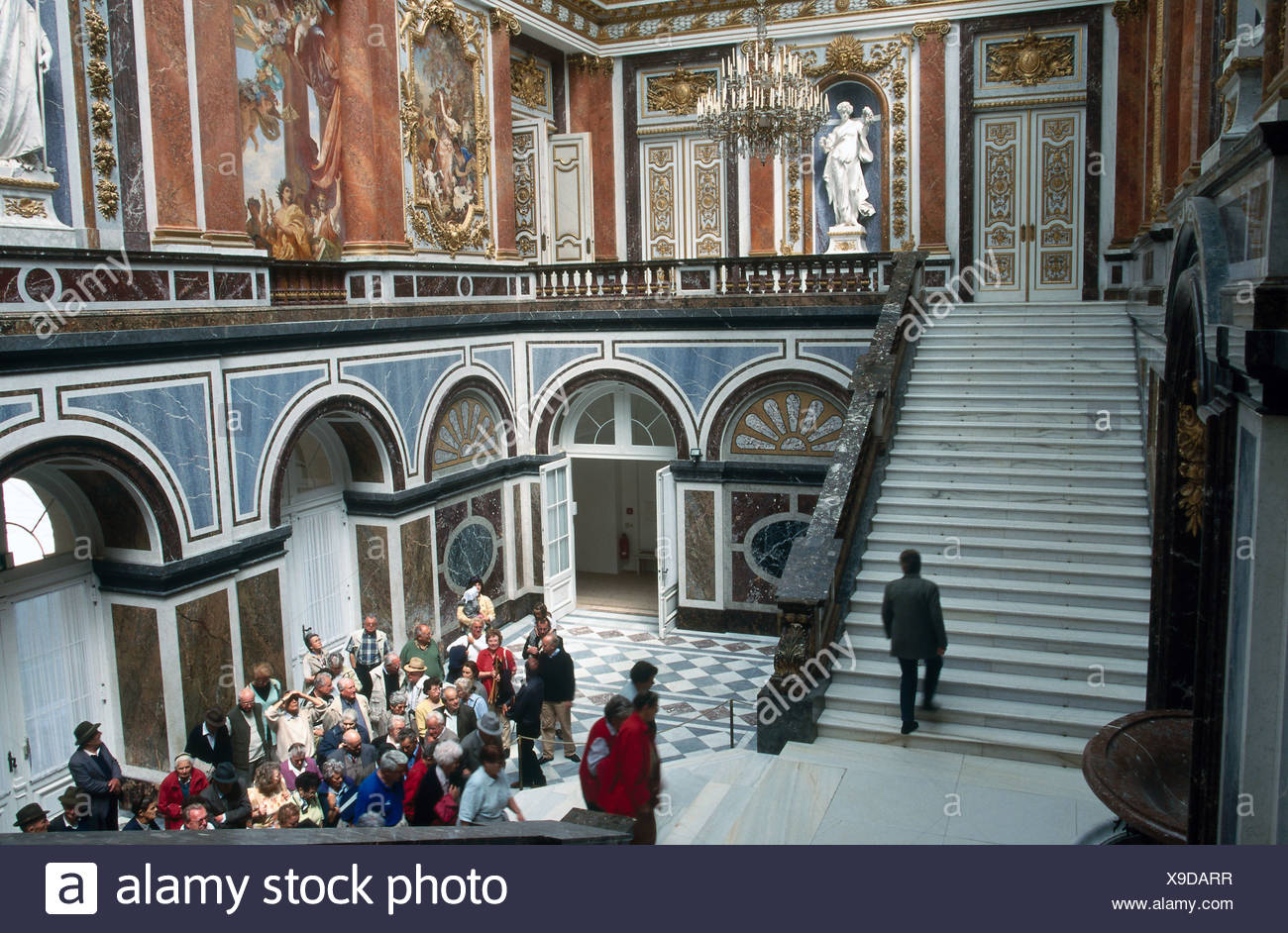 Tourists in castle, Herrenchiemsee Castle, Herreninsel, Bavaria, Germany - Stock Image