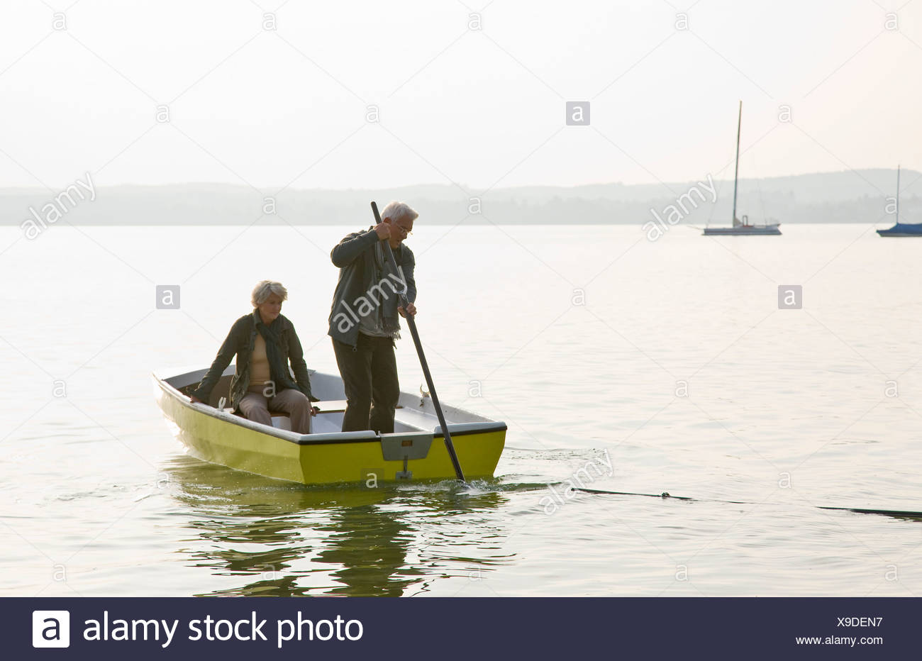 A senior couple in a rowing boat - Stock Image