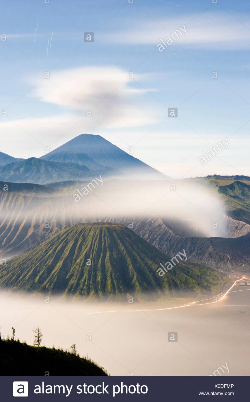 Sacred volcanoes known as Mount Semeru, Mount Bromo and Mount Batok. - Stock Image
