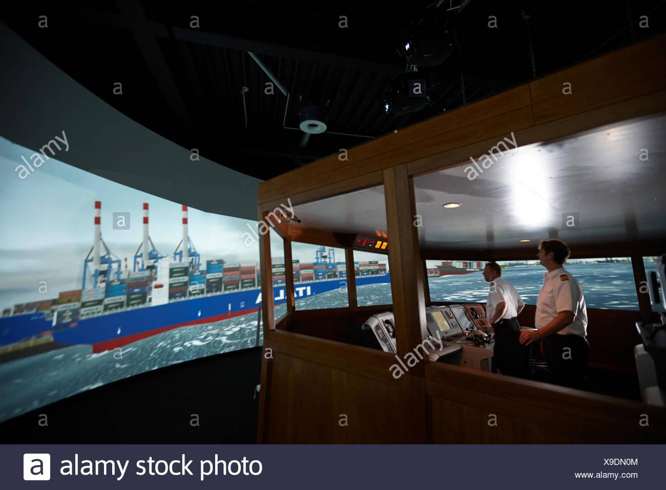 Captains at the MTC shiphandling simulator, Marine Training Center, Hamburg, Germany - Stock Image