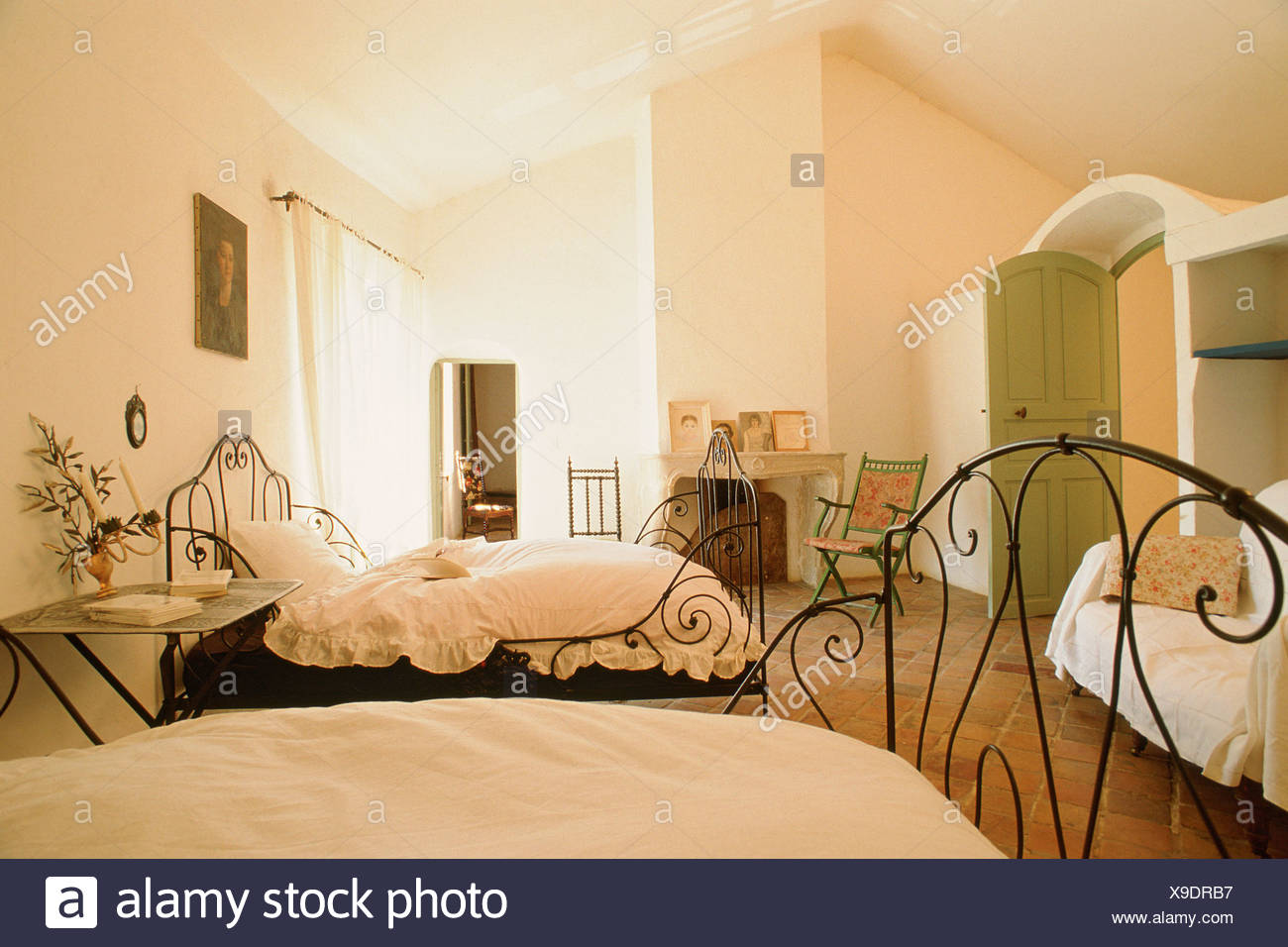 . Bedroom beds in wrought iron bench console table and armchair open