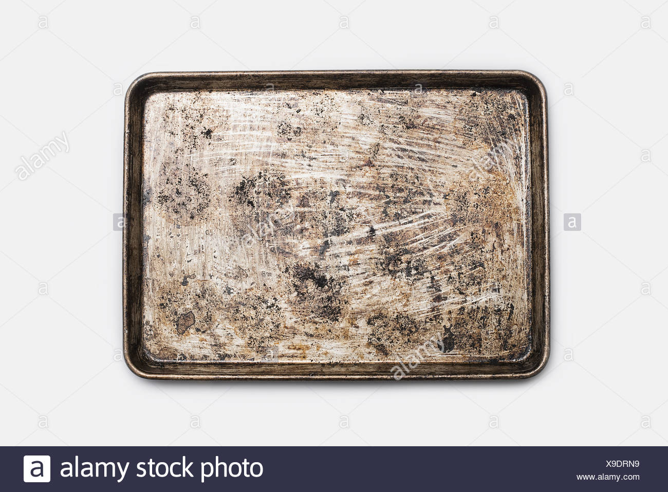 A well used, seasoned baking tray. Cookware. Baking sheet. Stock Photo