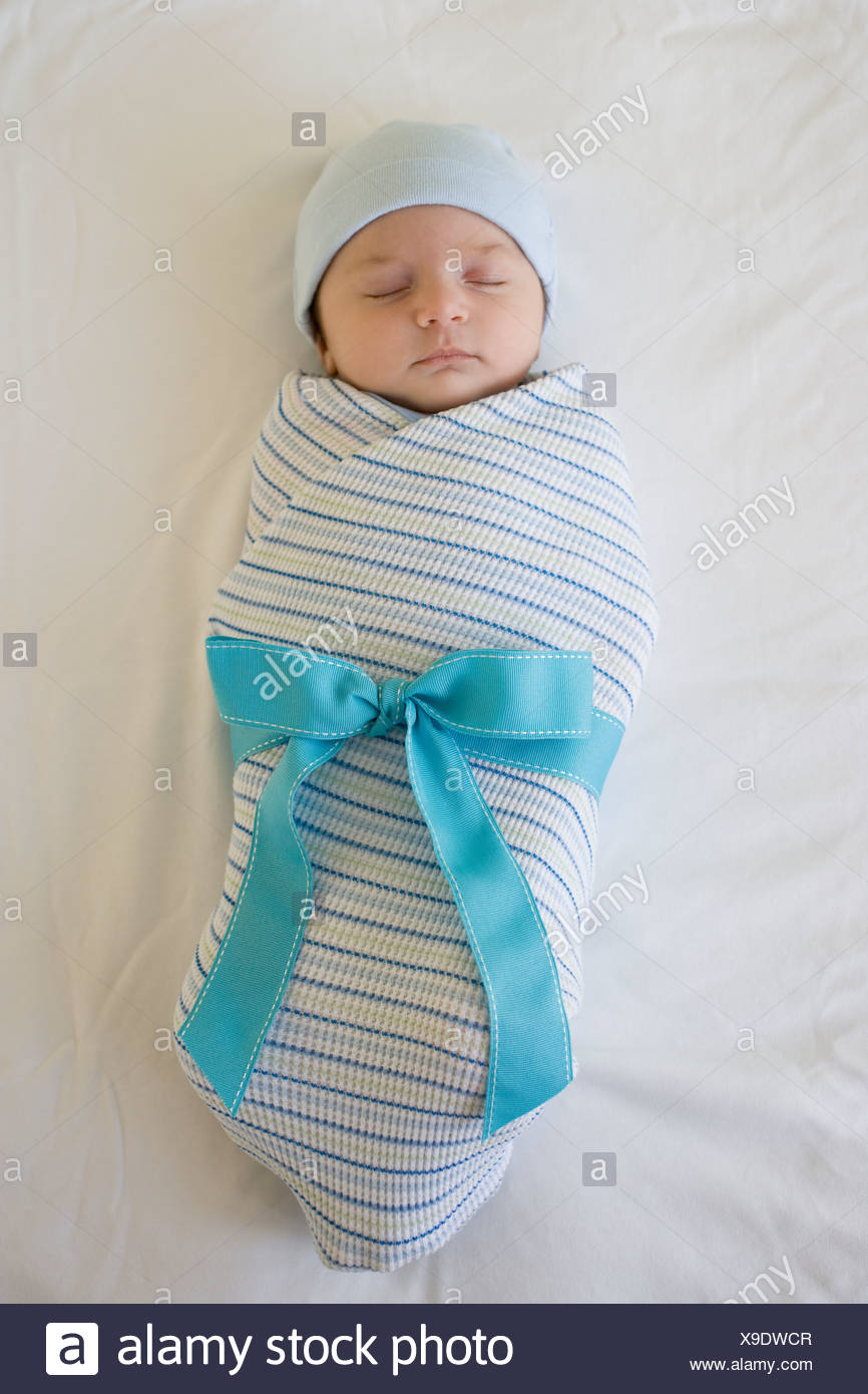 Baby Wrapped In Blanket With Bow Stock Photo 281203127 Alamy