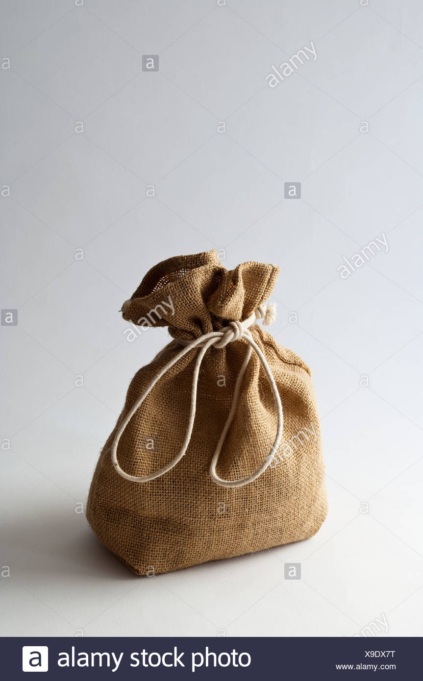 Brown sack tied with string, studio shot - Stock Image