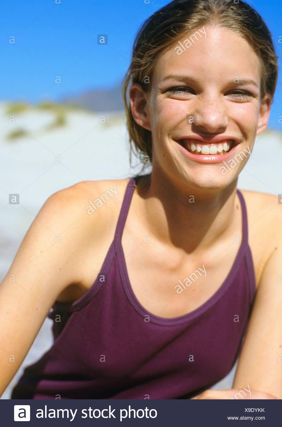 Woman laughs at camera Stock Photo