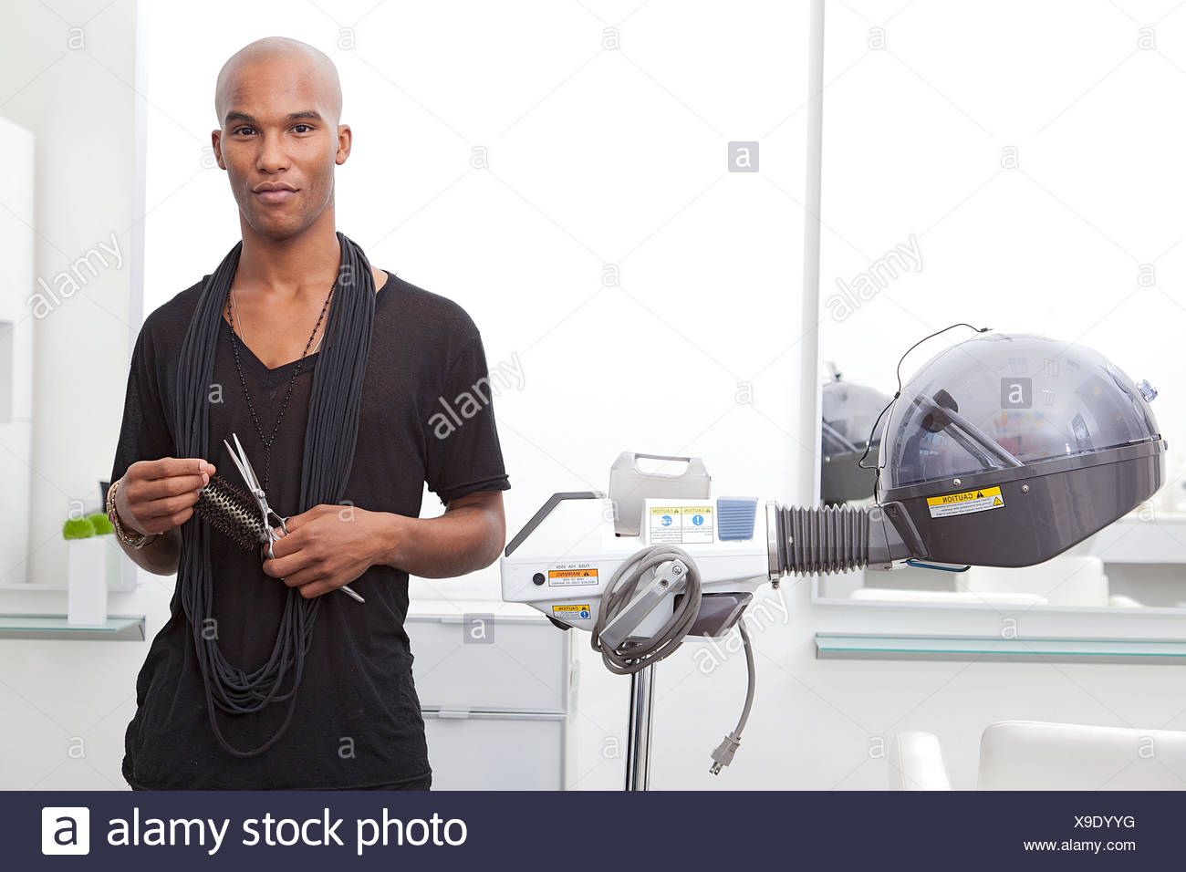 Portrait of African male hairdresser - Stock Image