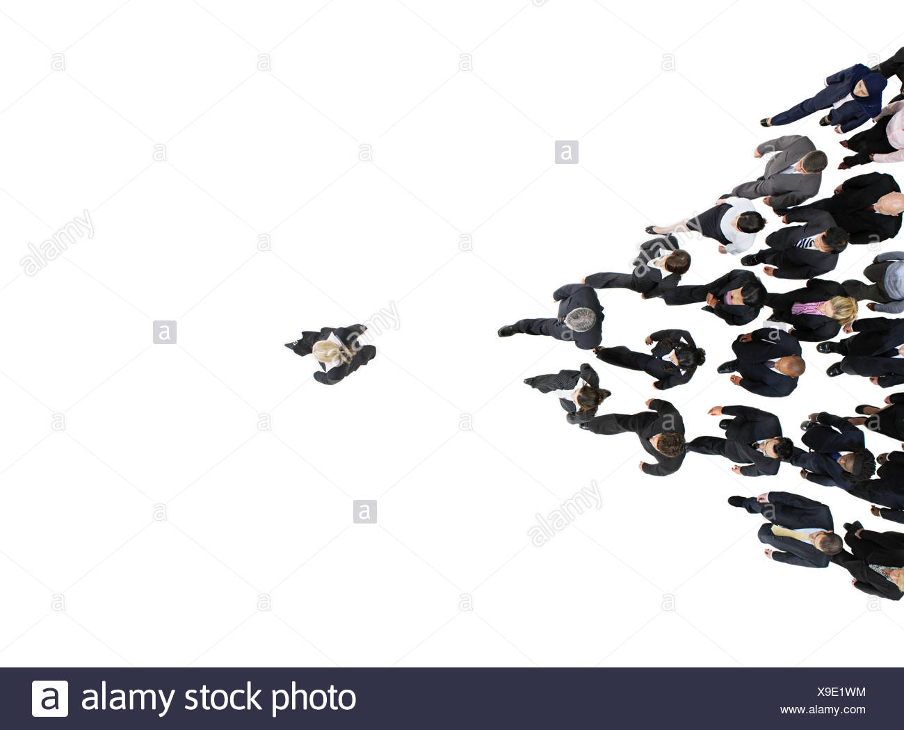 Businesspeople following businesswoman - Stock Image