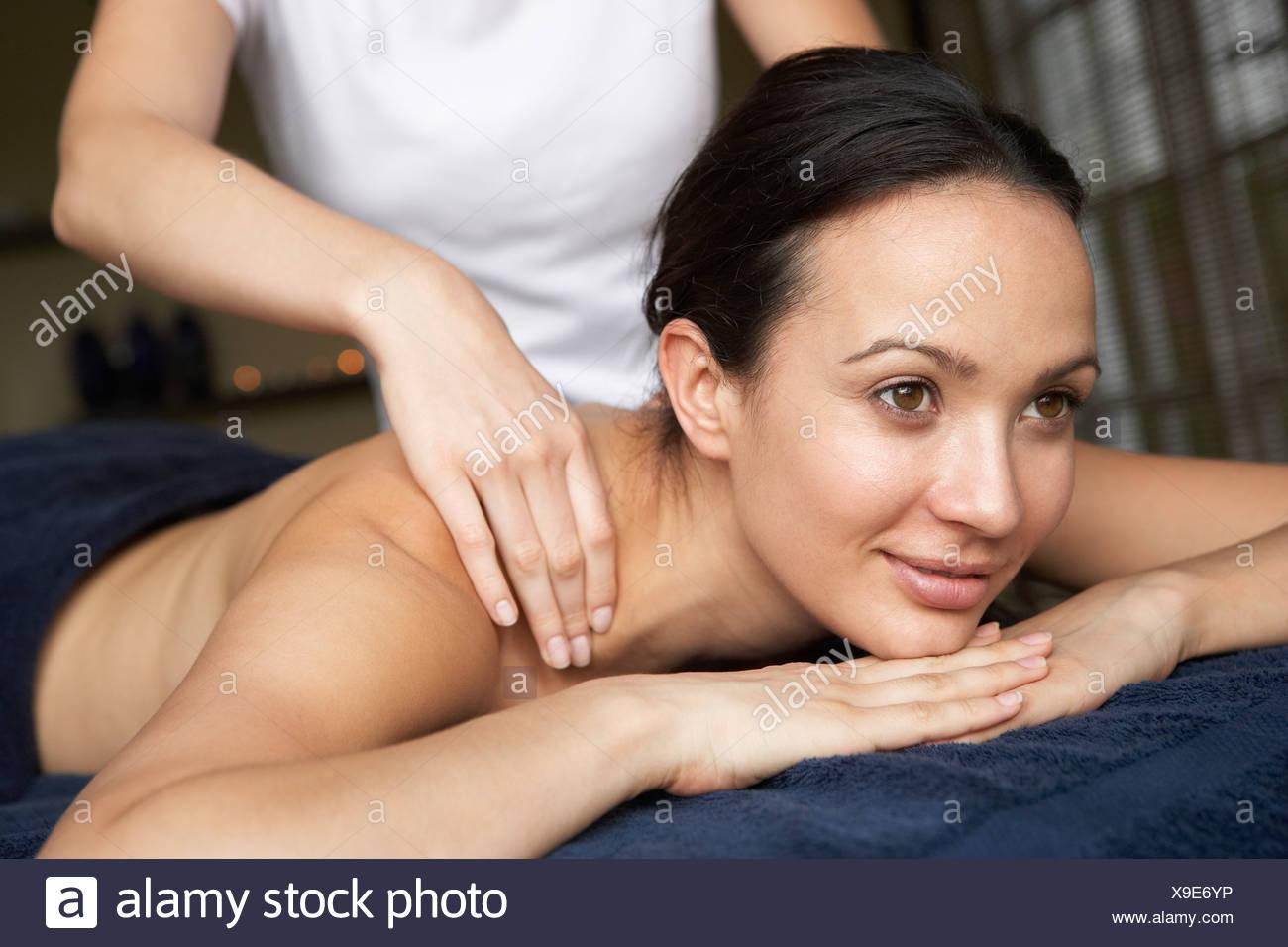Young Woman Enjoying Massage - Stock Image