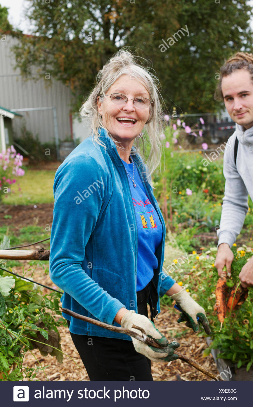 USA, Idaho, Sandpoint, Man and woman working in domestic garden - Stock Image