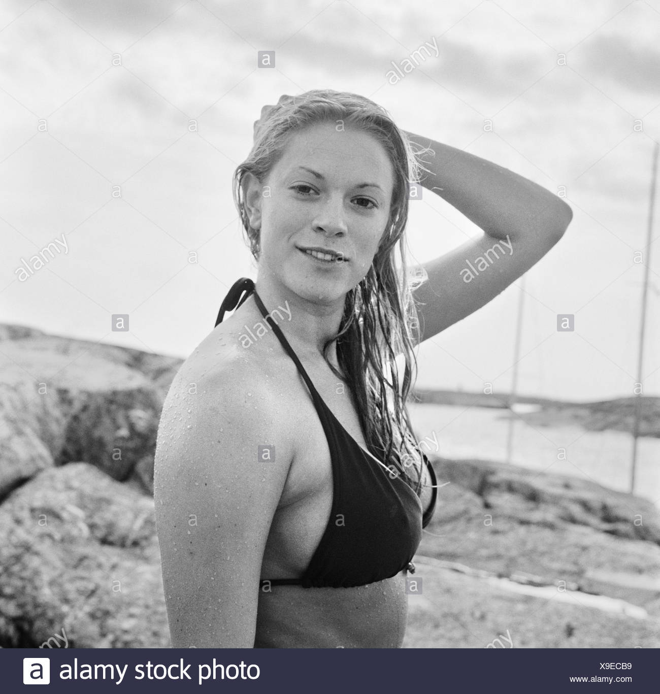 A young woman in bikini, Sweden. - Stock Image
