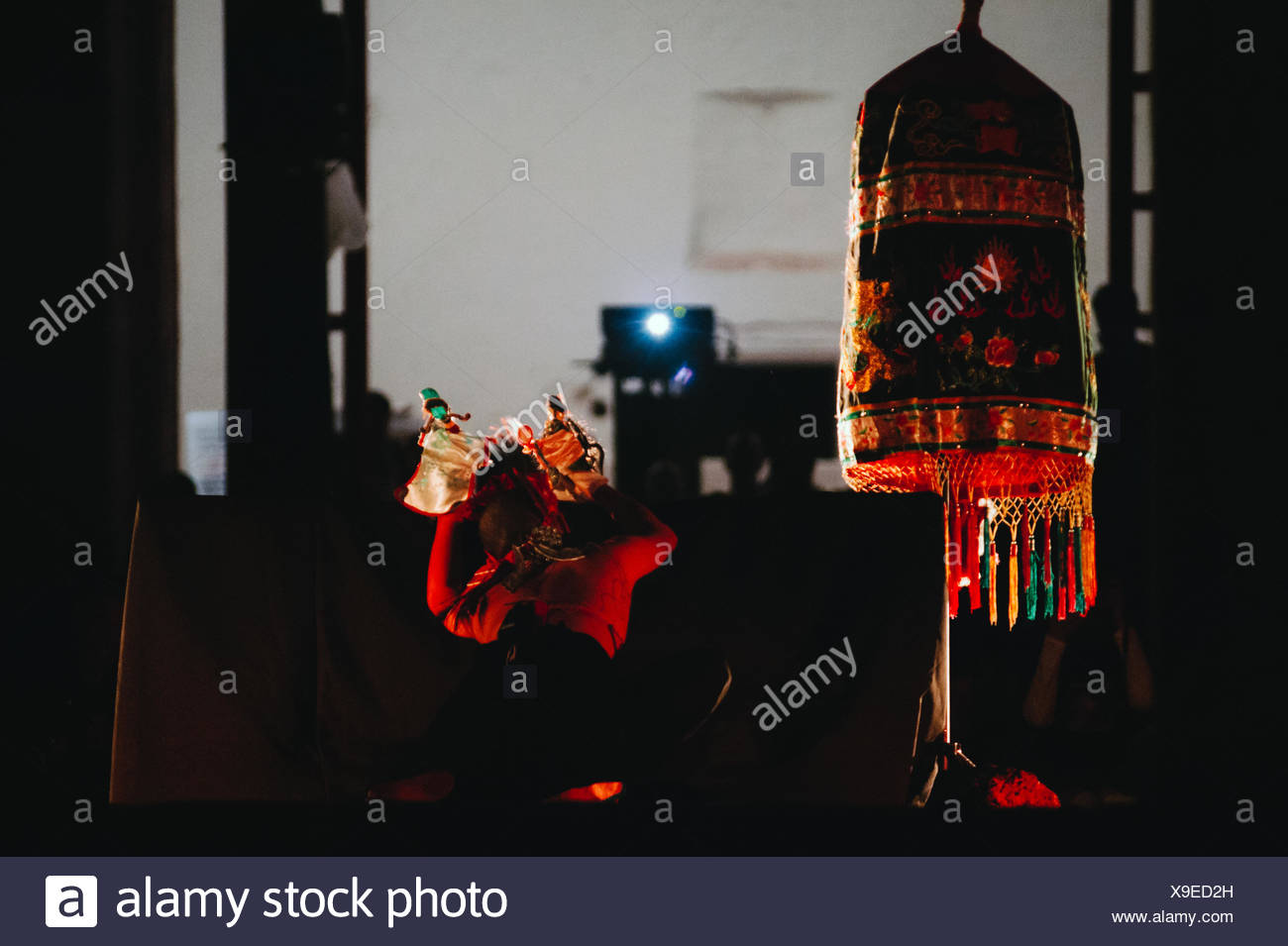 Rear View Of Dancer On Stage At Night - Stock Image