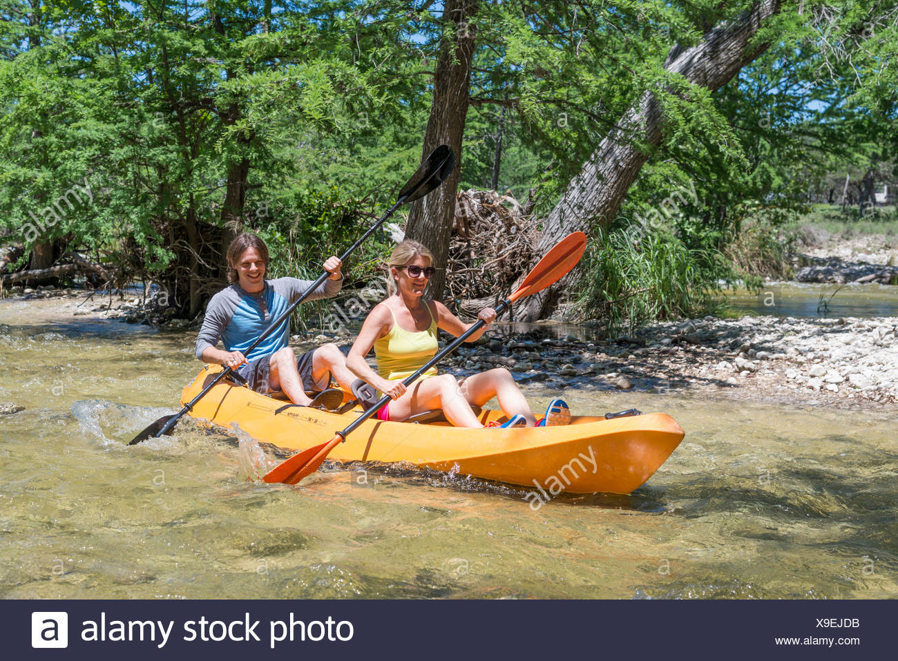 Woman Canoeing Down River Stock Photos & Woman Canoeing Down River