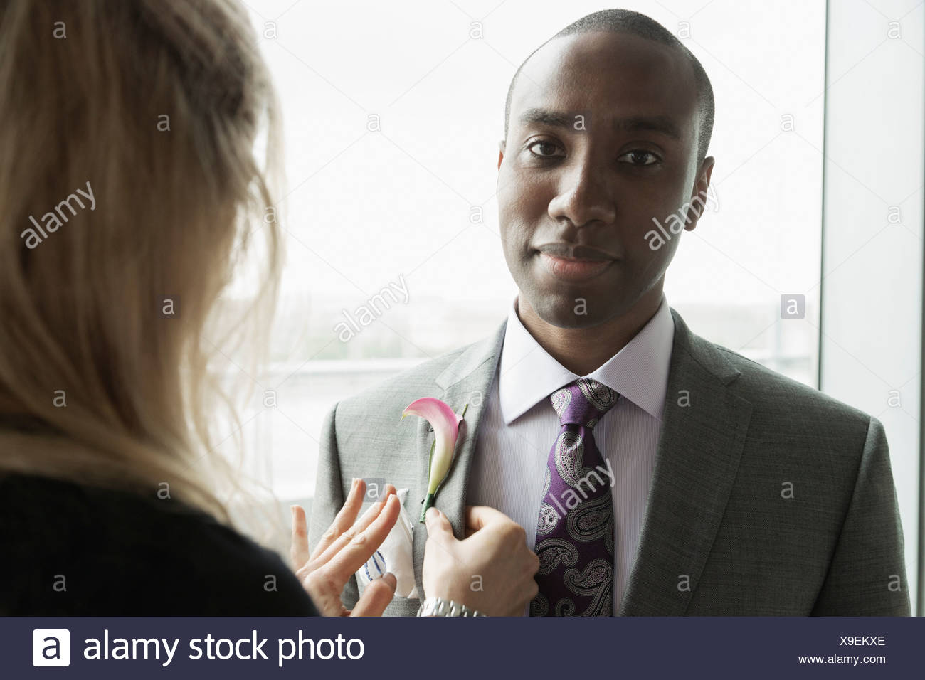 Bridegroom getting ready with help from friend - Stock Image