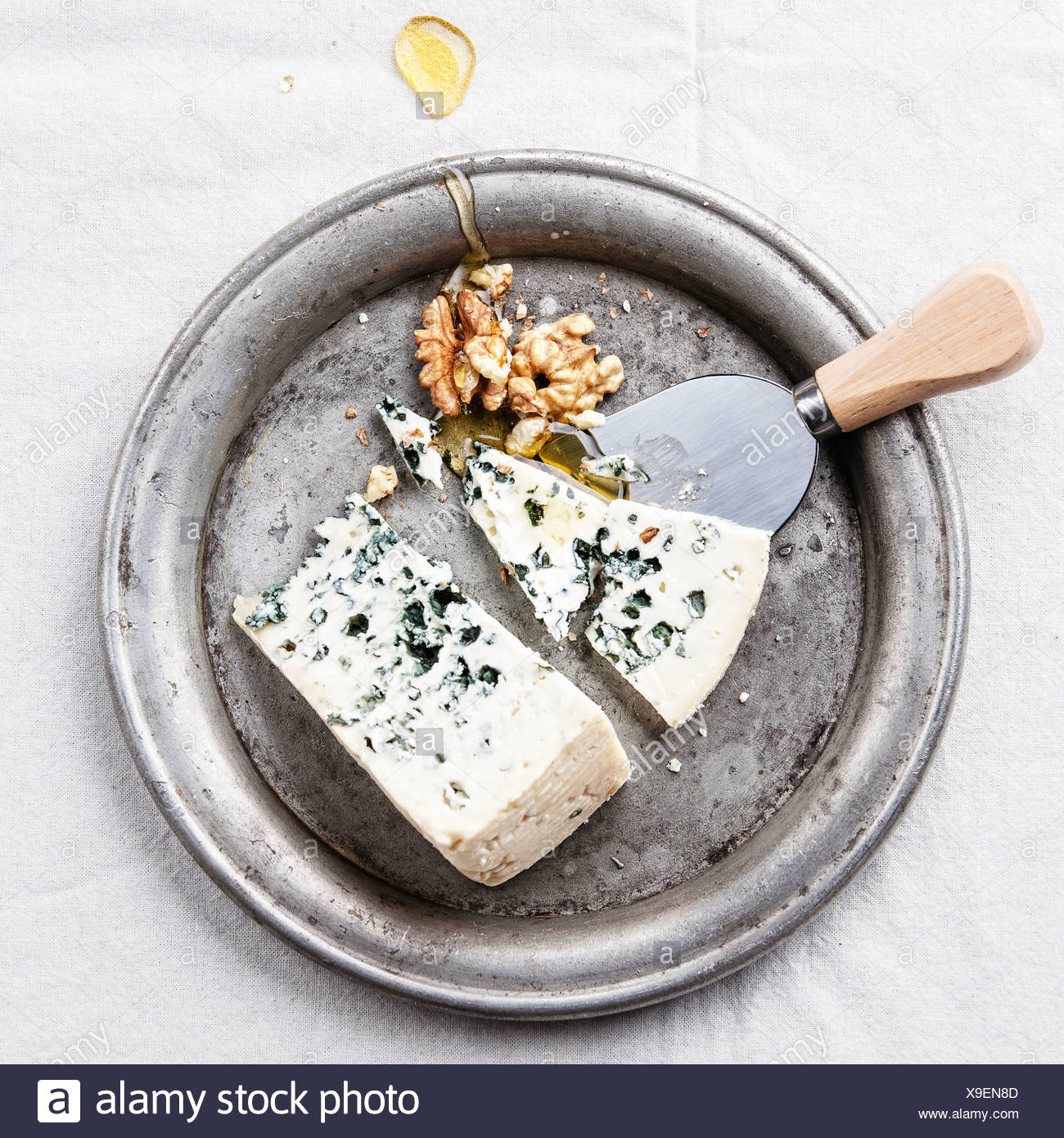 Dor Blue cheese with honey and nuts on plate - Stock Image