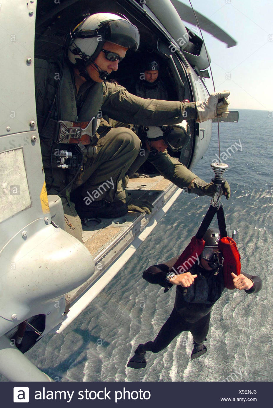 Atlantic Ocean - A Sailor assigned to the Explosive Ordnance Disposal Mobile Unit Six (EODMU-6), Detachment 16, is hoisted out - Stock Image