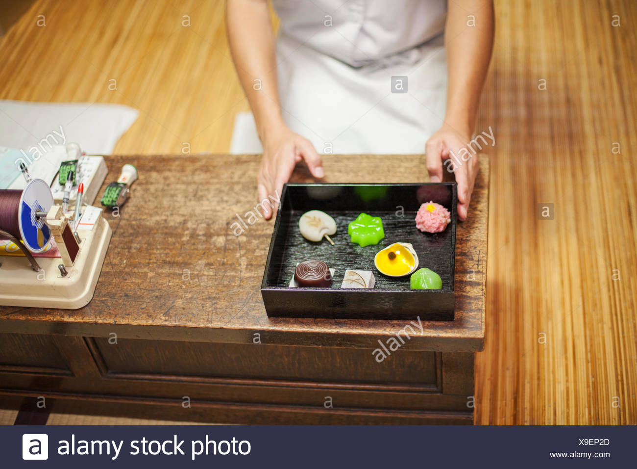 A small artisan producer of wagashi presenting a tray of selected wagashi of different shapes and flavours. - Stock Image