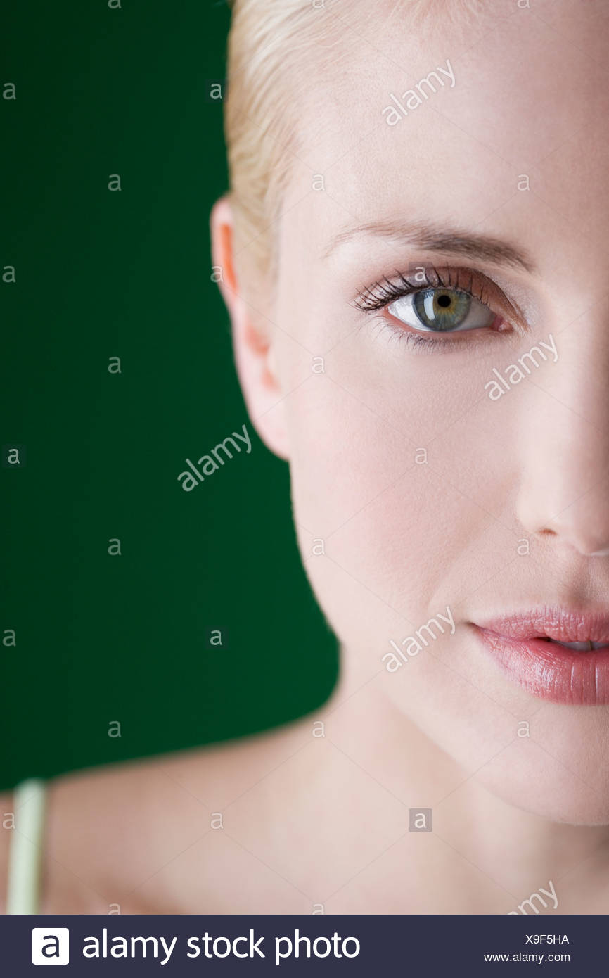 A portrait of a young blonde woman, left hand side of face - Stock Image