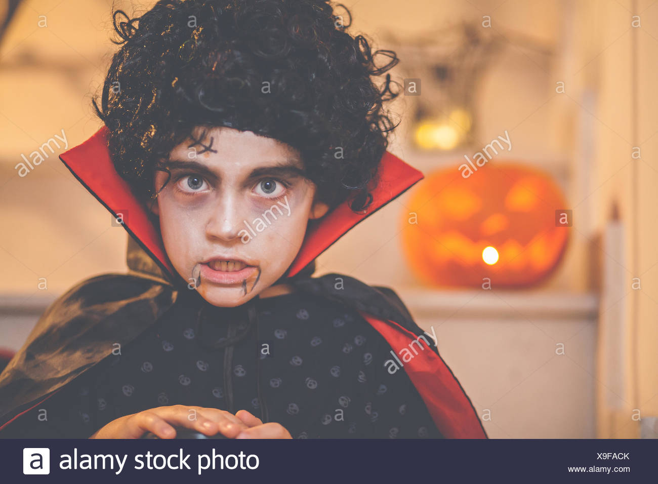 Portrait of a boy wearing a halloween dracula costume - Stock Image