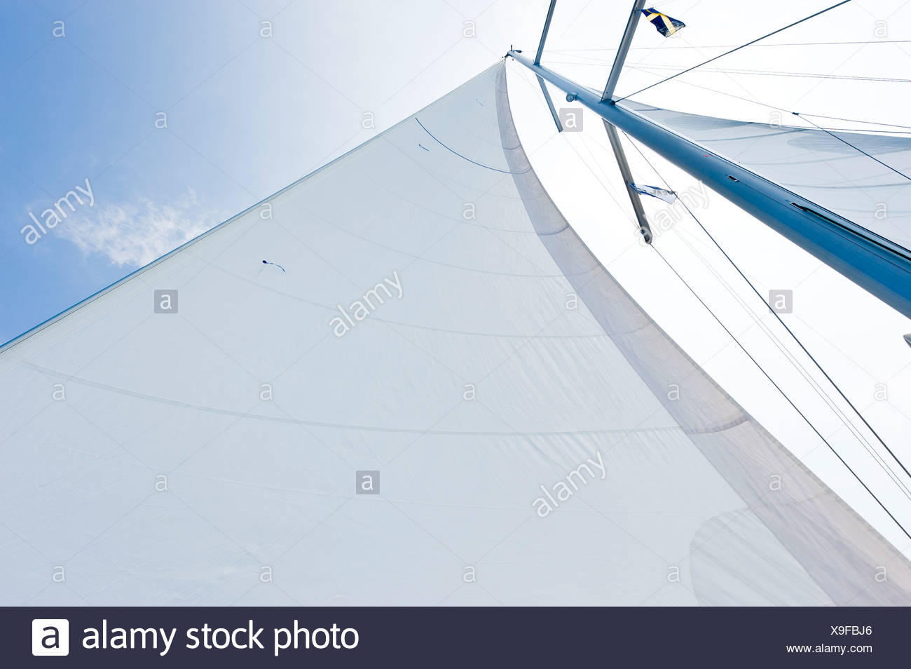 Close-up of a sail bermuda rigged against the sky - Stock Image