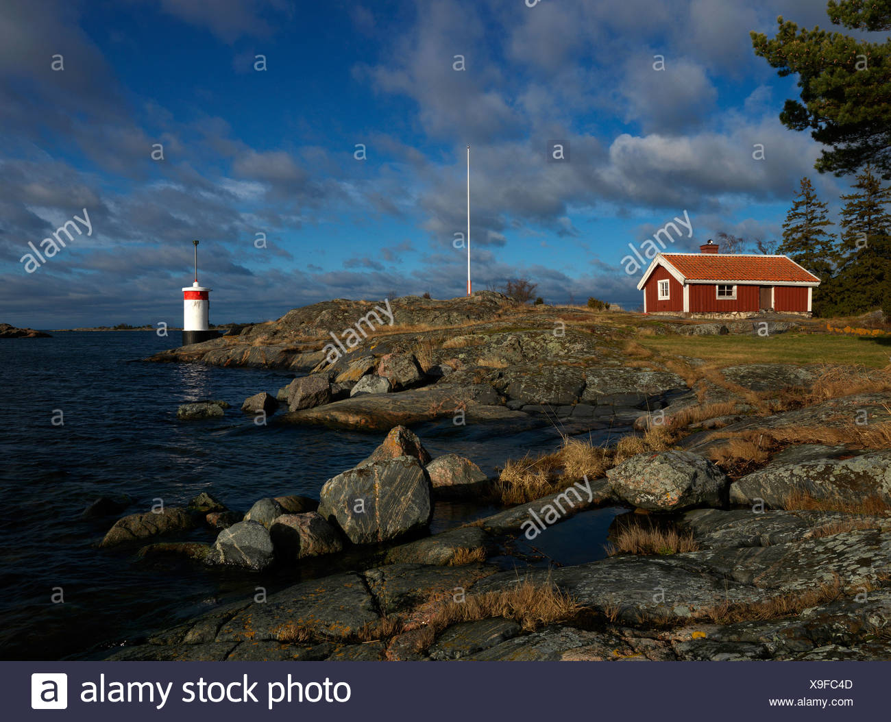 House and a lighthouse Tjust archipelago Sweden. - Stock Image