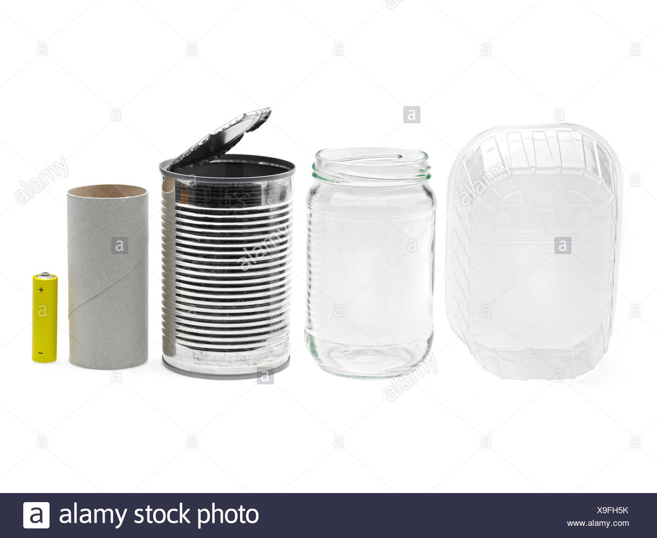 Close-up of tins and aluminum jars in a line against white background - Stock Image