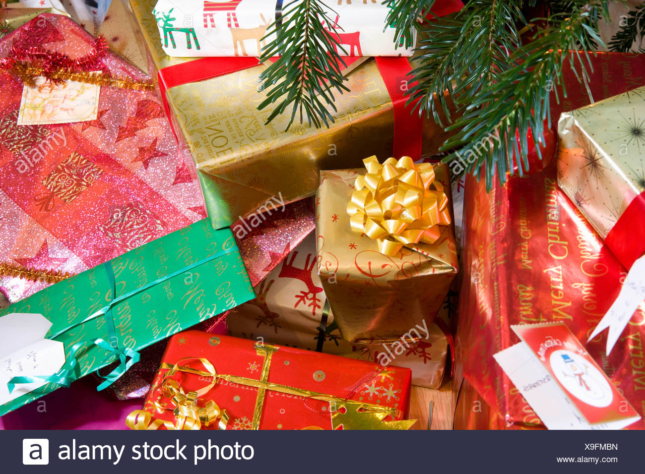 Christmas presents under decorated tree - Stock Image