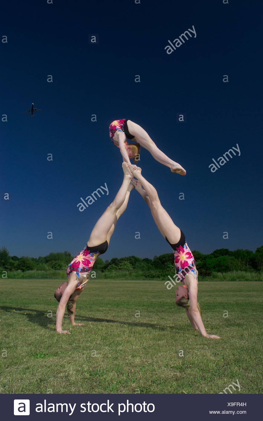 Acrobatic troop performing moves - Stock Image