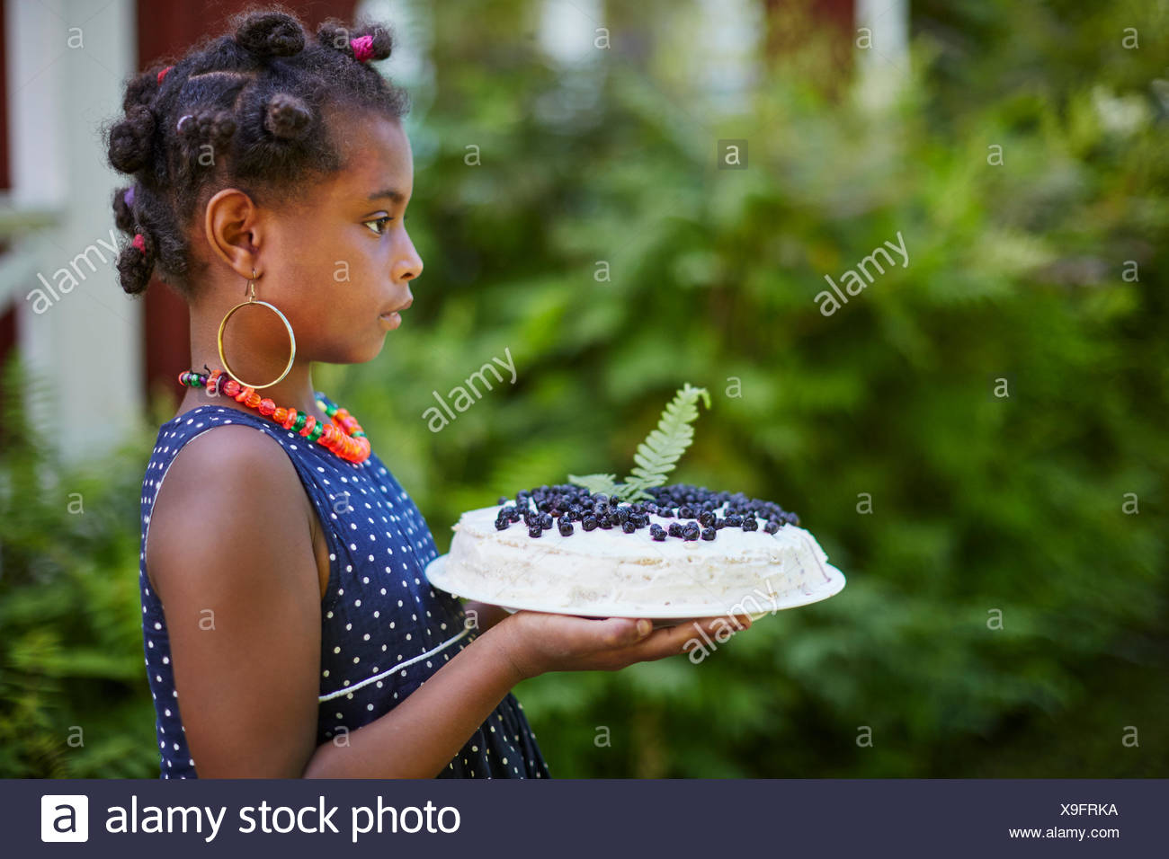 Girl holding cake with blueberries Stock Photo
