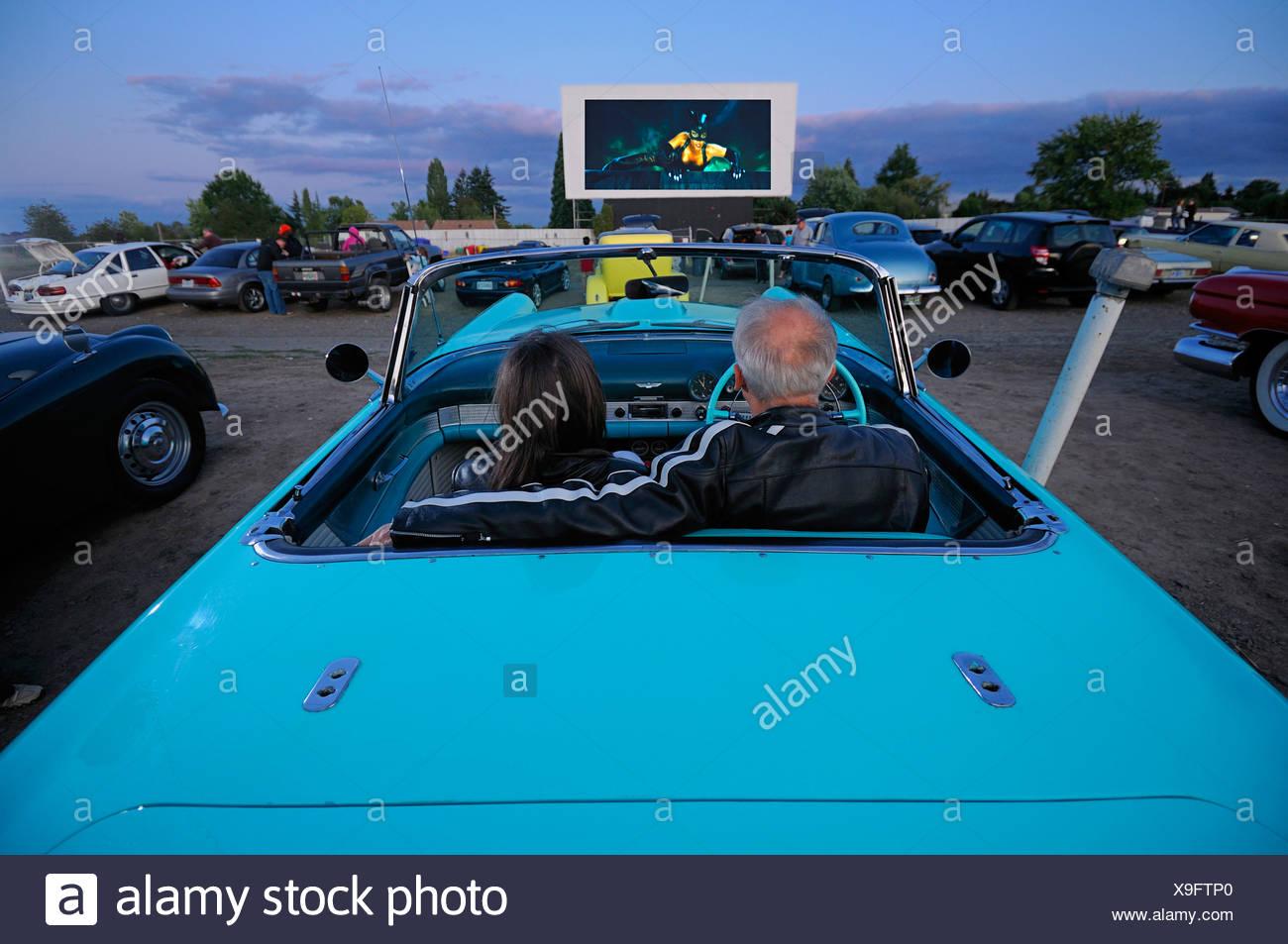 man woman couple with Classic car car 1955 T-Bird Motor Vu Drive In Dallas Oregon USA - Stock Image