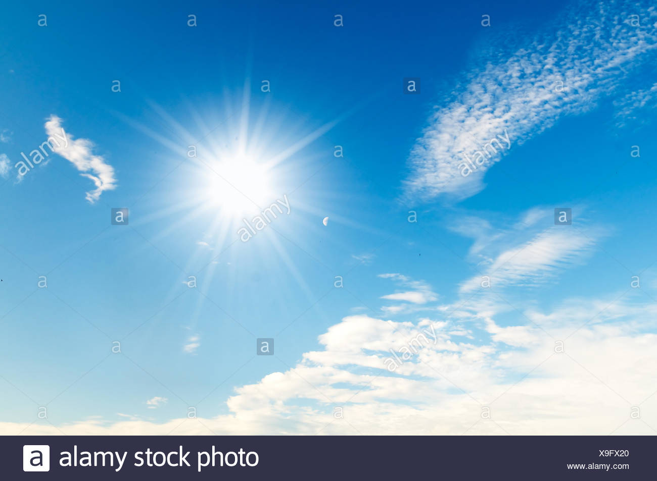 Sunny blue sky with fluffy clouds - Stock Image
