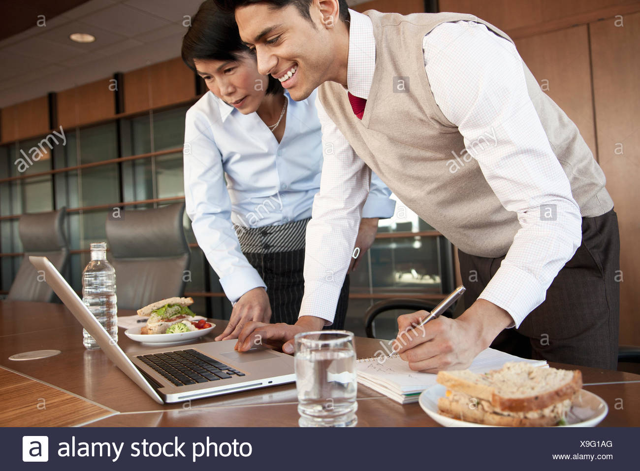coworkers at luncheon meeting - Stock Image