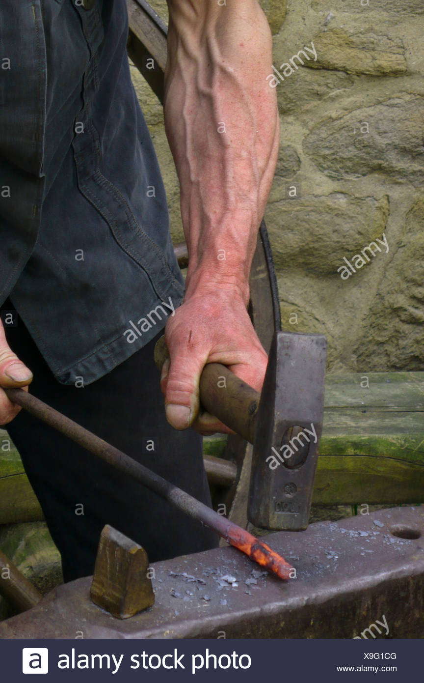 traditional handcraft, smith at work, strike while the iron is hot, Germany - Stock Image
