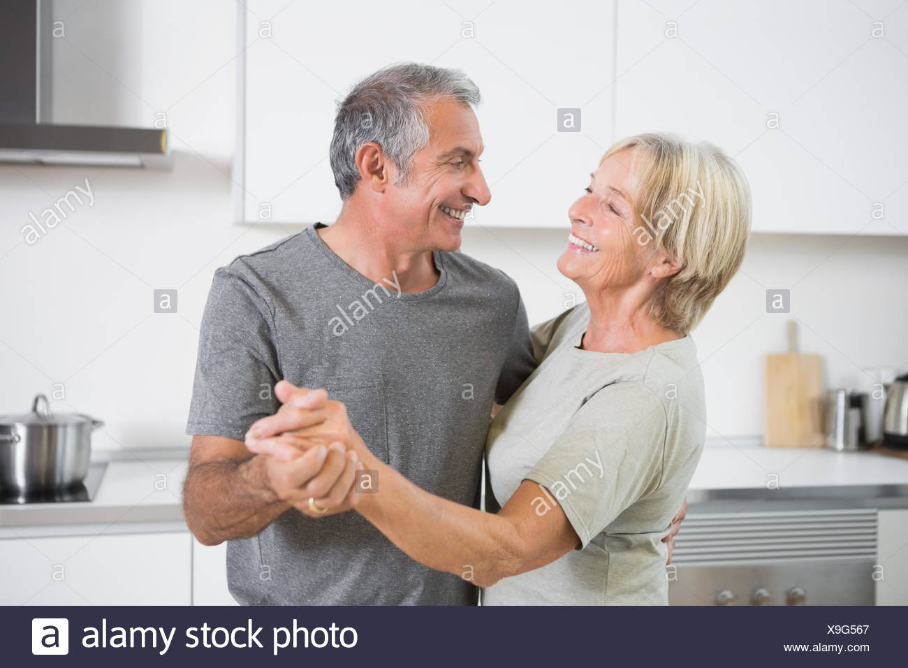 Happy couple dancing together - Stock Image