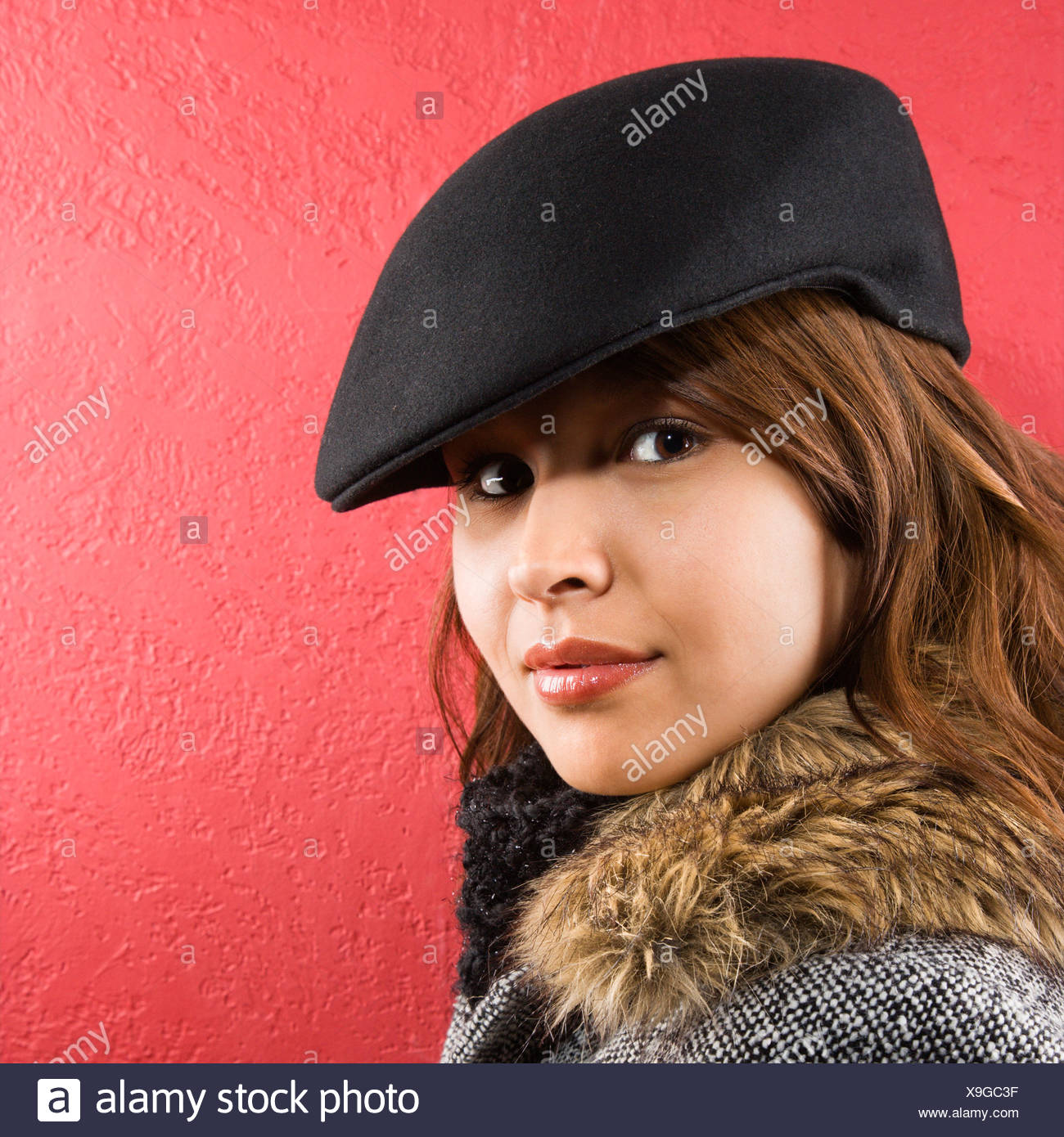b0e23f03896aa Young adult Caucasian woman wearing flat hat looking at viewer Stock ...