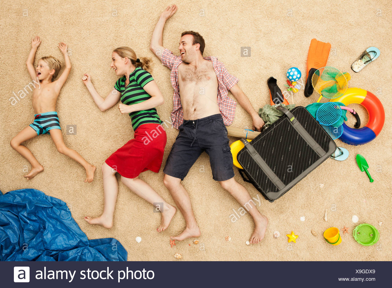 Germany, Family with toys and baggage at beach - Stock Image