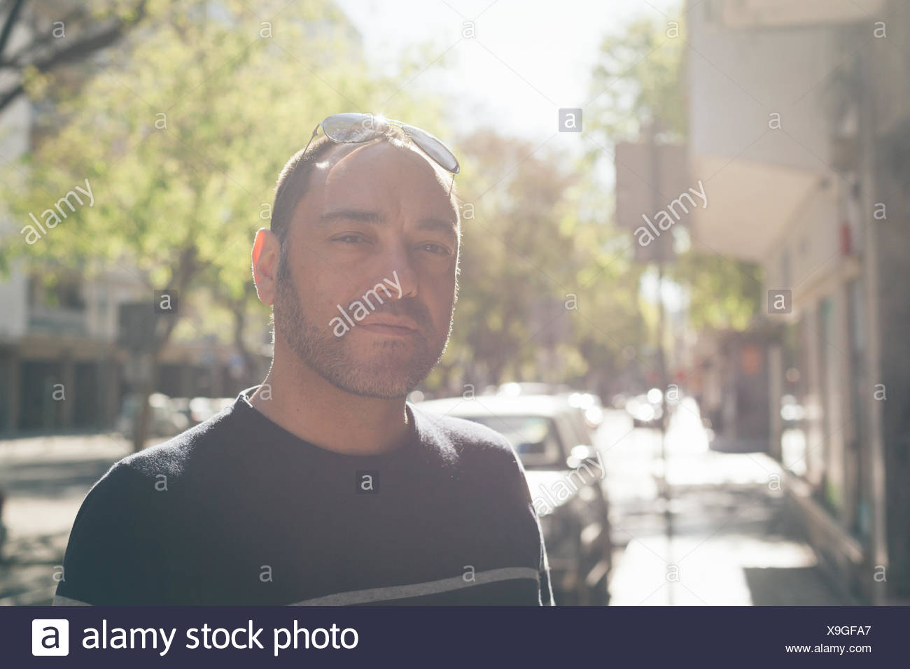 Portrait Of Mid Adult Man Standing On Footpath - Stock Image
