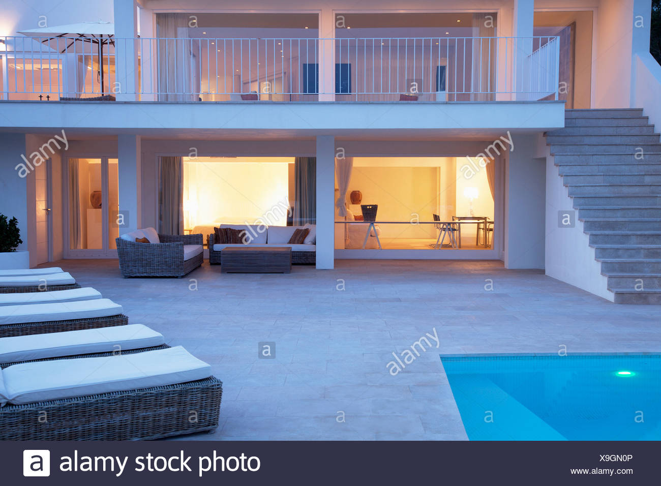 Pool and patio area of modern house - Stock Image