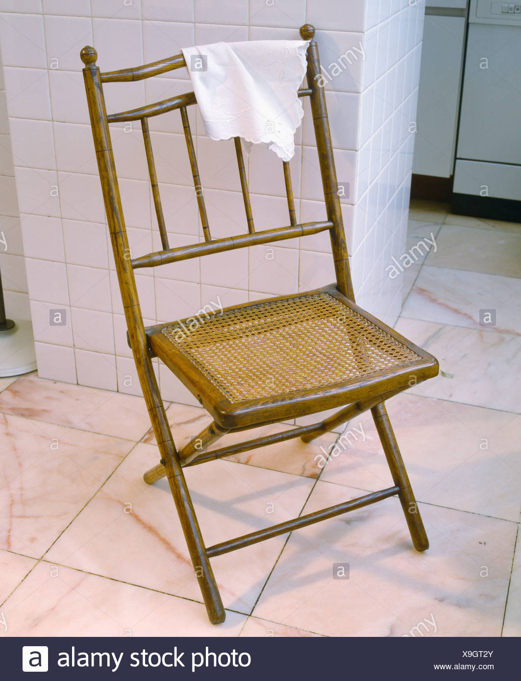 Excellent Antique Cane And Bamboo Folding Chair On White Tiled Floor Ncnpc Chair Design For Home Ncnpcorg