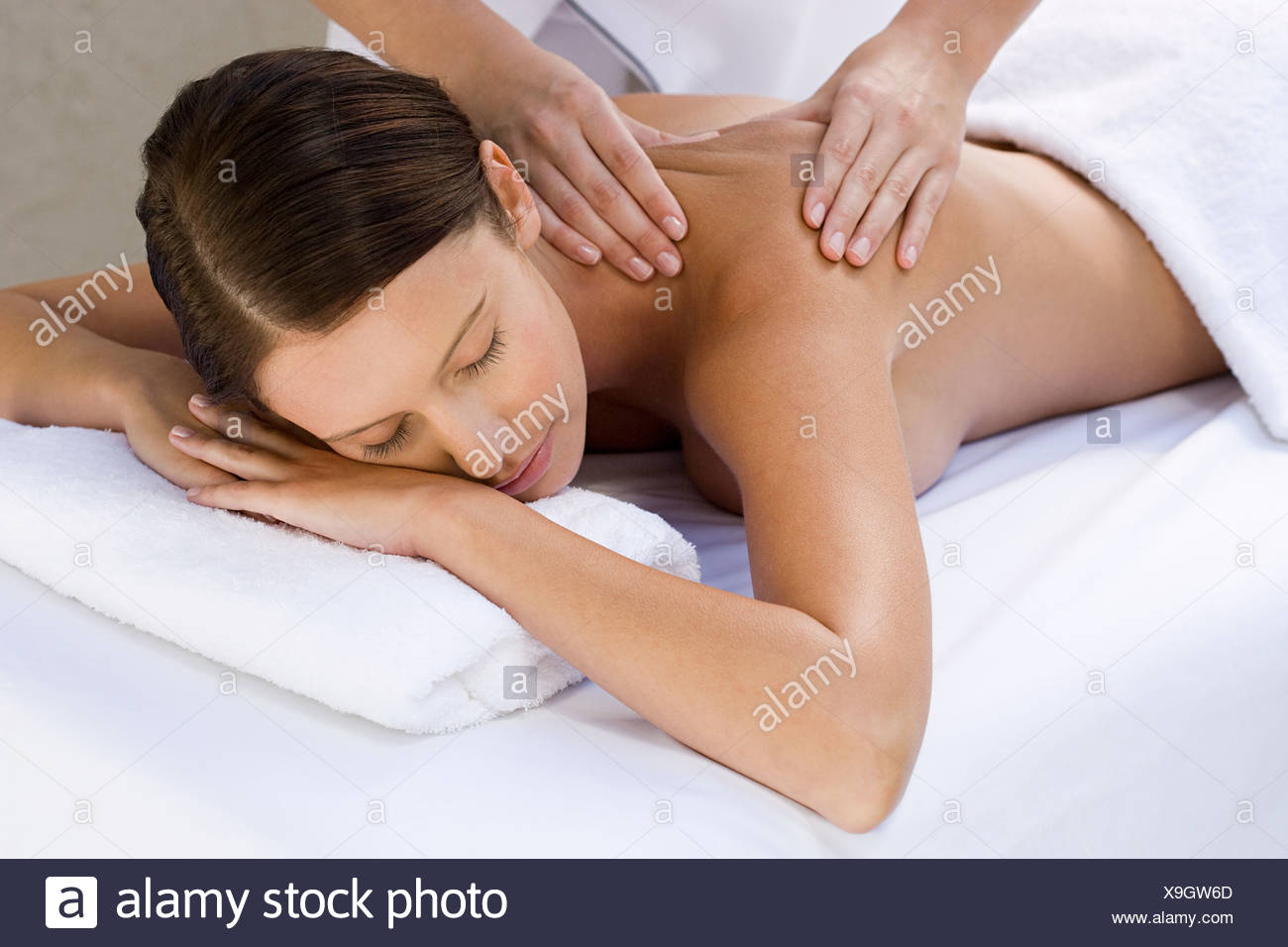 Young woman receiving massage Stock Photo