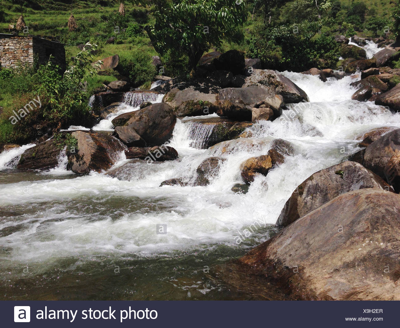 River flowing over rocks - Stock Image