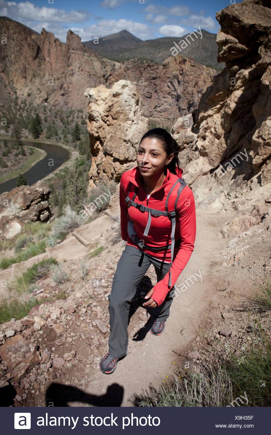 Female hiking rocky trail. - Stock Image