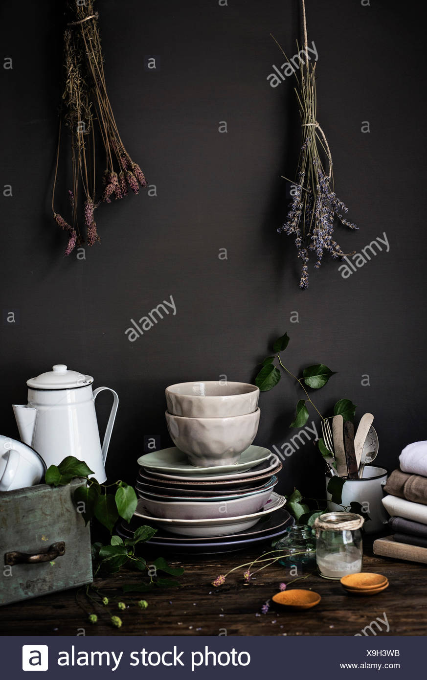Vintage food props over an old wooden table - Stock Image