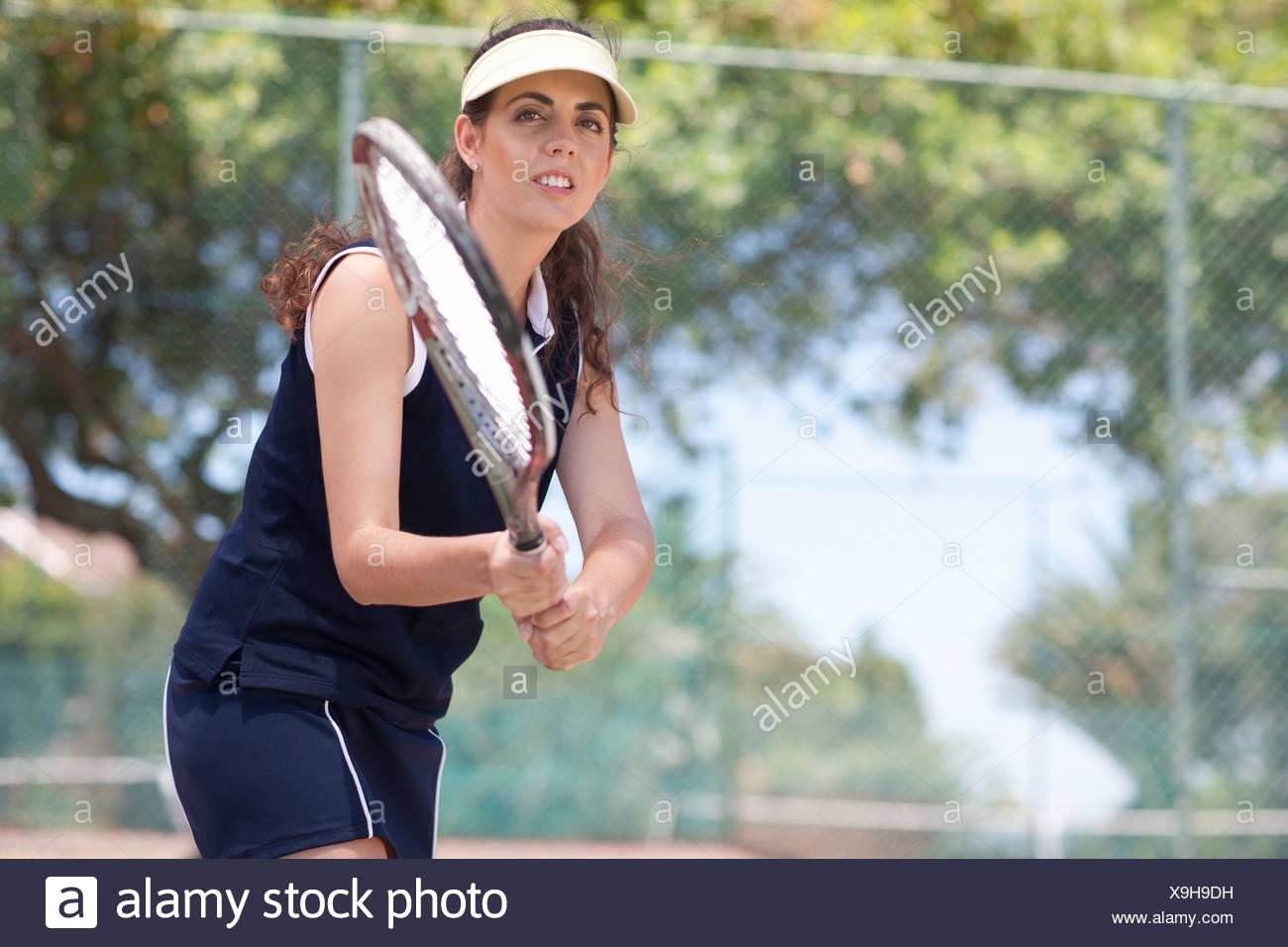 Tennis players returning ball - Stock Image