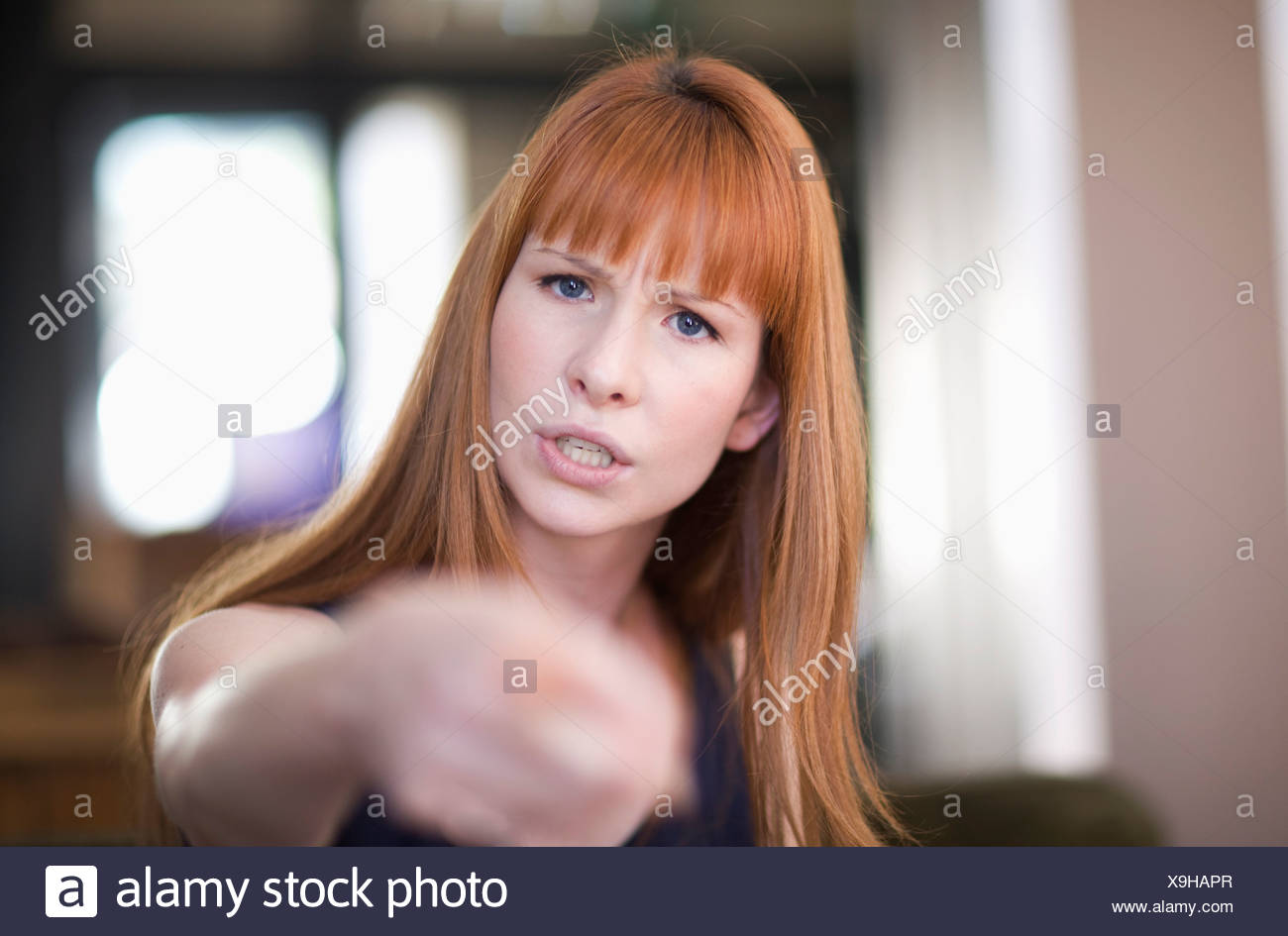 Woman argueing with somebody - Stock Image