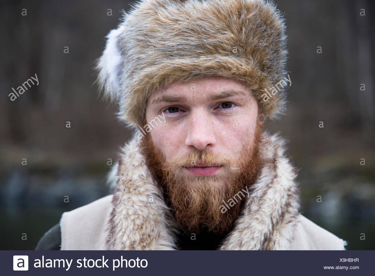 Mid adult man wearing trapper hat e463a6480ebd