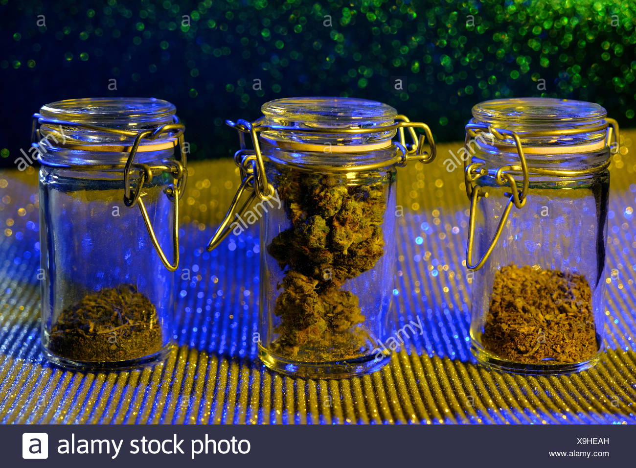 A stylized image of cannabis or marijuana in glass jars. - Stock Image