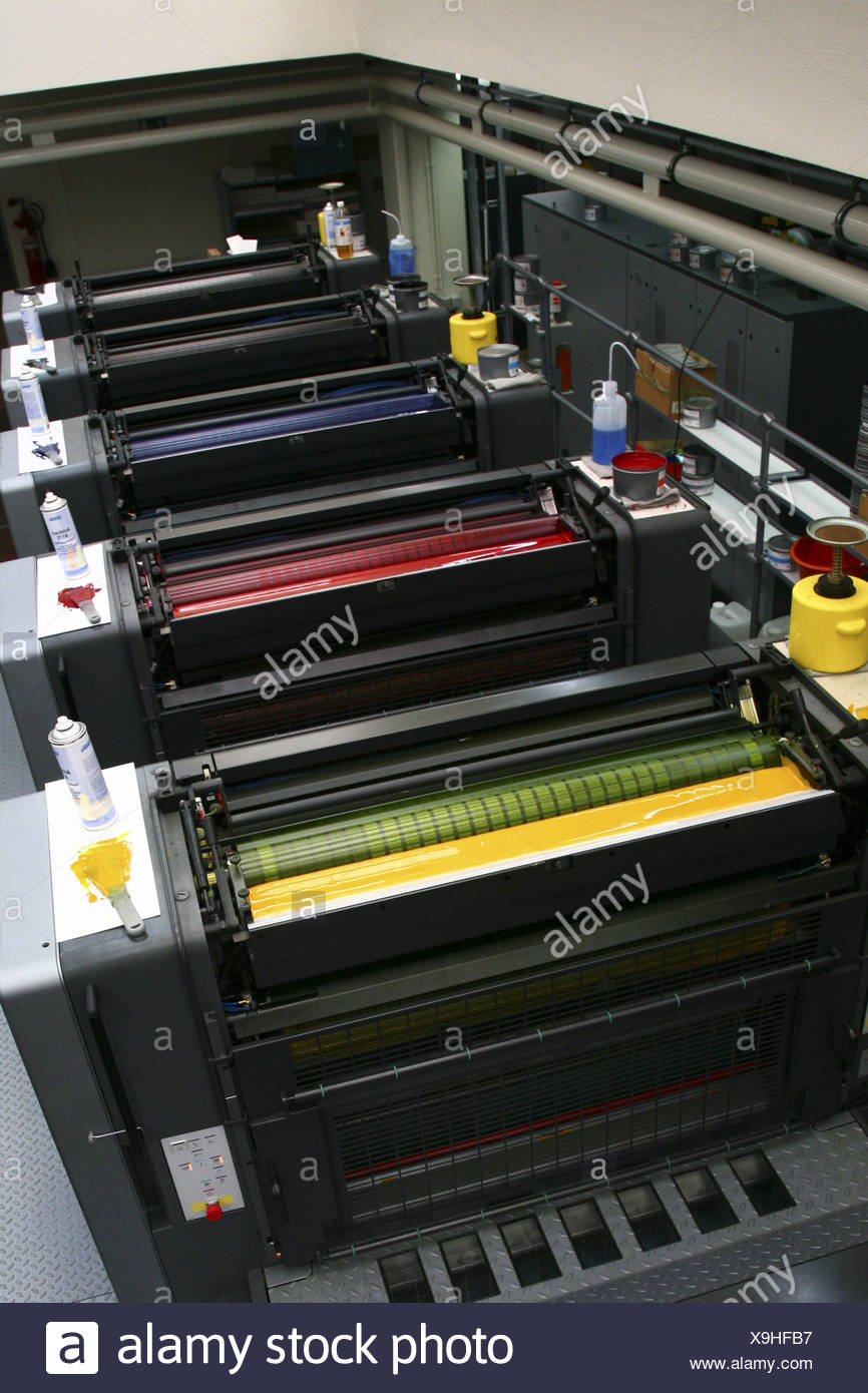 Pressure-machine color-works detail economy industry printing work machine technology cylinders color-cylinders - Stock Image