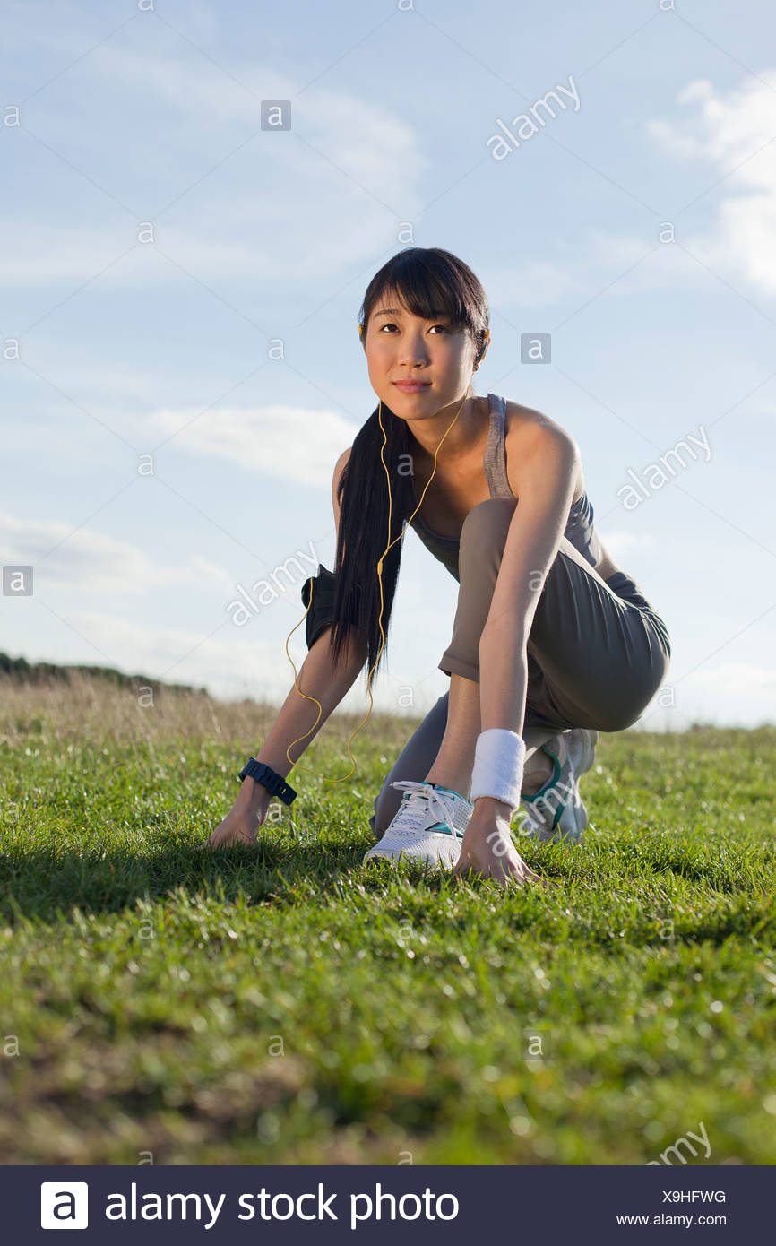 Young woman preparing for run - Stock Image