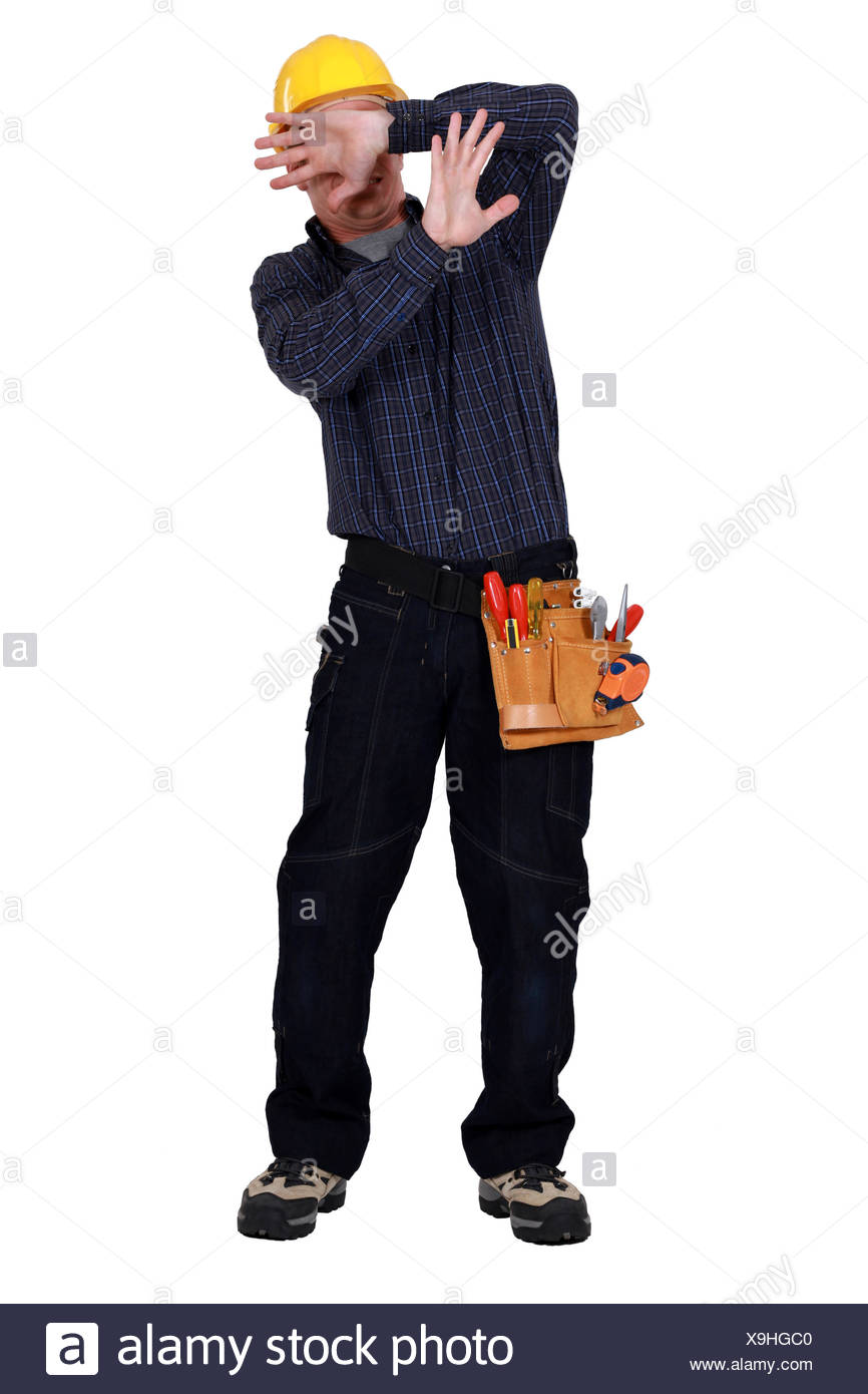 craftsman protecting his face - Stock Image